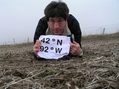 #2: Getting Grounded:  Joseph Kerski at the confluence of 42 North 92 West.