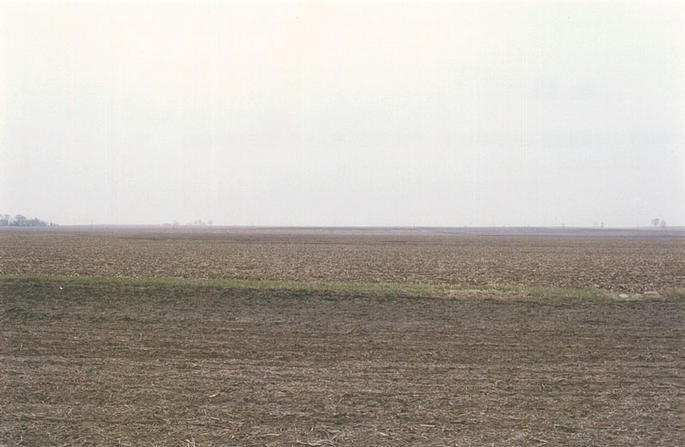 Looking south.  The green strip nearby is the east-west boundary between