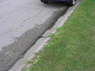 #1: The confluence point lies either on the street, or the grass verge