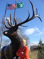#8: Cynthia poses at the namesake of Elk Grove Village