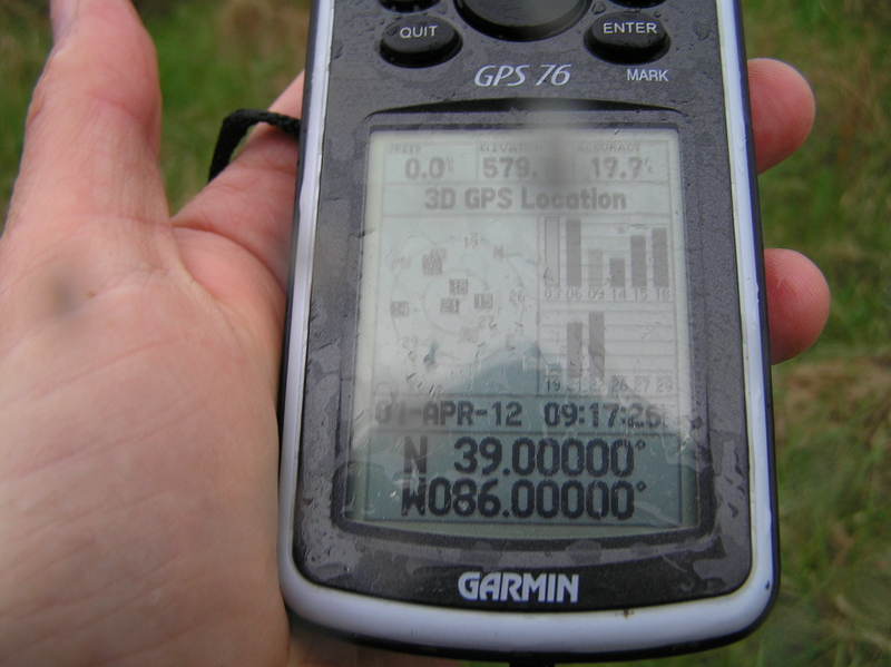 Success despite the rain:  The GPS receiver at the confluence point.