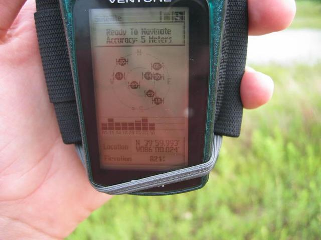 Holding the GPS as close to the site as I could get (without getting my feet muddy)