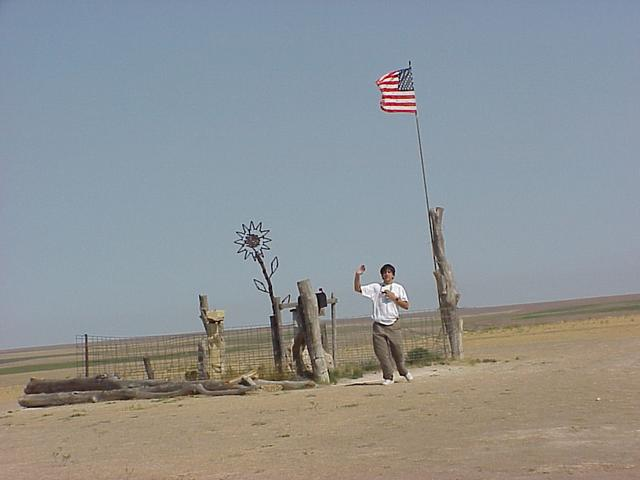 Joseph Kerski at Mount Sunflower, highest point in Kansas, approximately three miles northwest of confluence.