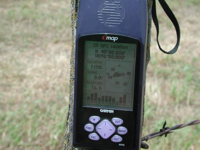 Closeup of GPS on confluence fence post