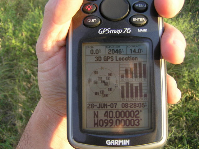 As I was walking away from the confluence, a rare sight:  Recording position from 12 GPS satellites!