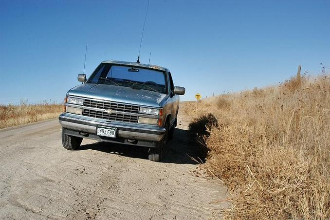 "Picture of my truck zero'ing, with the state-line road ""T"" sign behind it"
