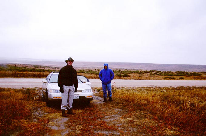 The car parked 0.8 miles from the confluence.  Dan (left) and Ben (right)