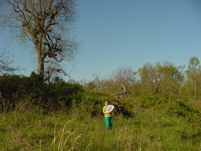 Christa standing at confluence in front of fallen tree, facing NE