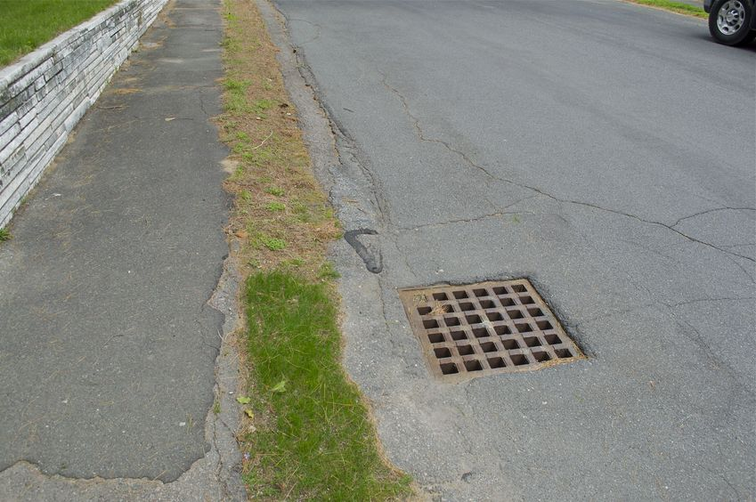 The confluence point lies on this suburban road, close to this storm drain