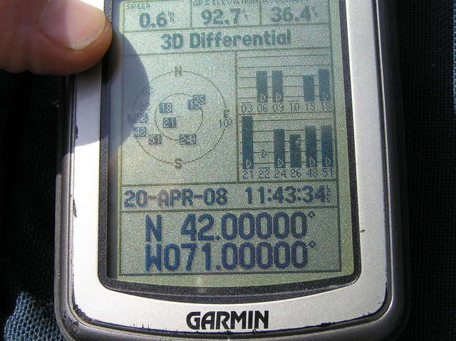 GPS reading at the confluence in the middle of the street.