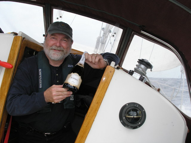 Captain Culver with champagne for celebratation
