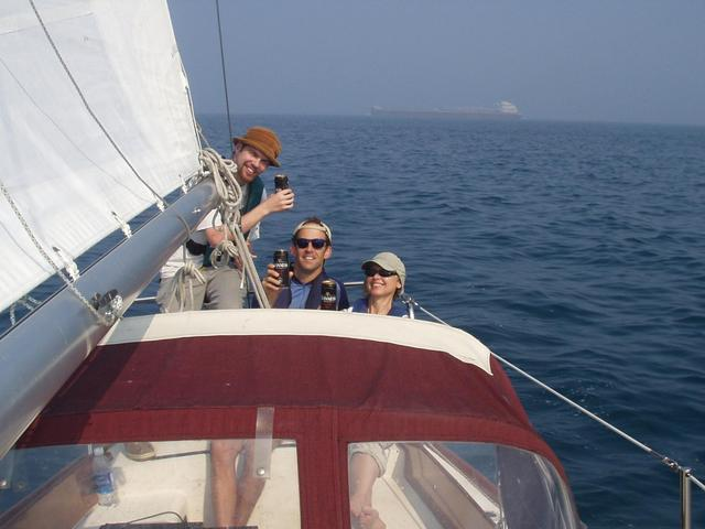 The crew celebrates while a laker passes our stern: Mitch, Andy, & Sally