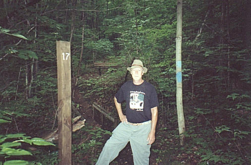Dan at mile marker 17 --Just about the area that we headed north into the woods.