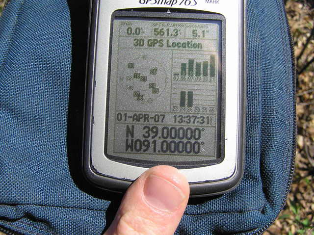 GPS at the confluence site, 1.5 meters south of the fenceline.