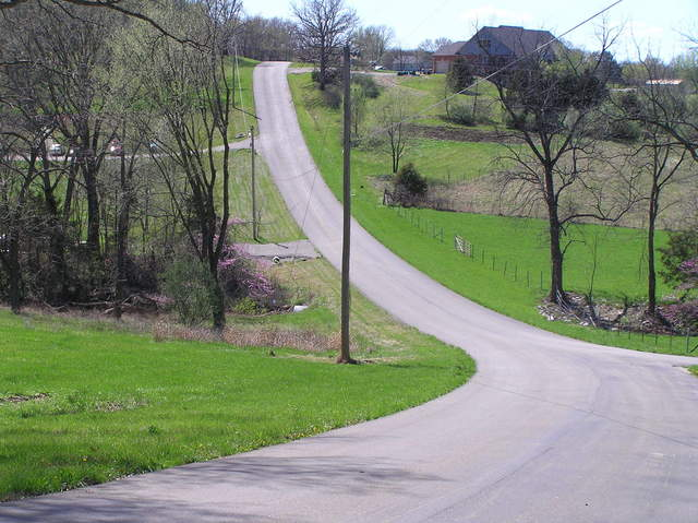 Nearest road to the confluence:  Looking west from the driveway of 130 Spring Creek Road.