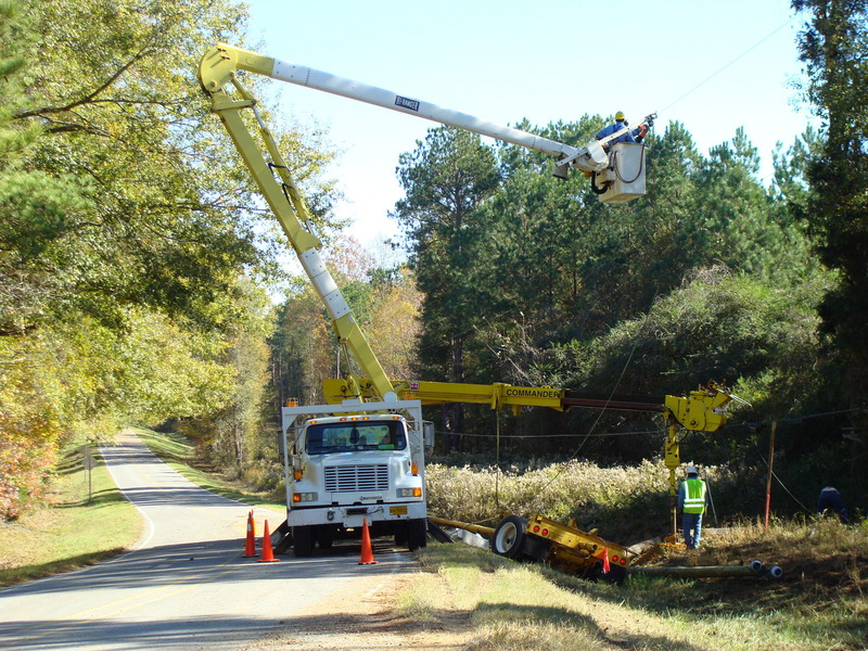 East Mississippi Electric Power Association crew prepares to install new utility pole.
