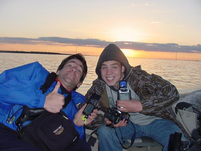 AJ Torgerson, Shiloh Christian School, and Joseph Kerski, USGS, at the confluence in Devils Lake.  Devils Lake is quite famous for perch, walleye, northern pike, and bass fishing.