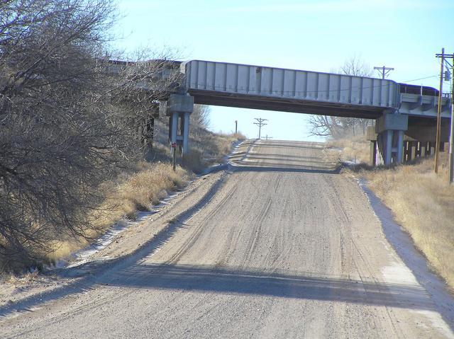 Road about 200 meters north of the confluence, looking west to the railroad overpass.