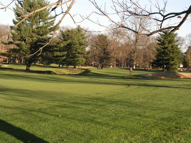 Grounds crew works on 4th green, north of 40N 75W