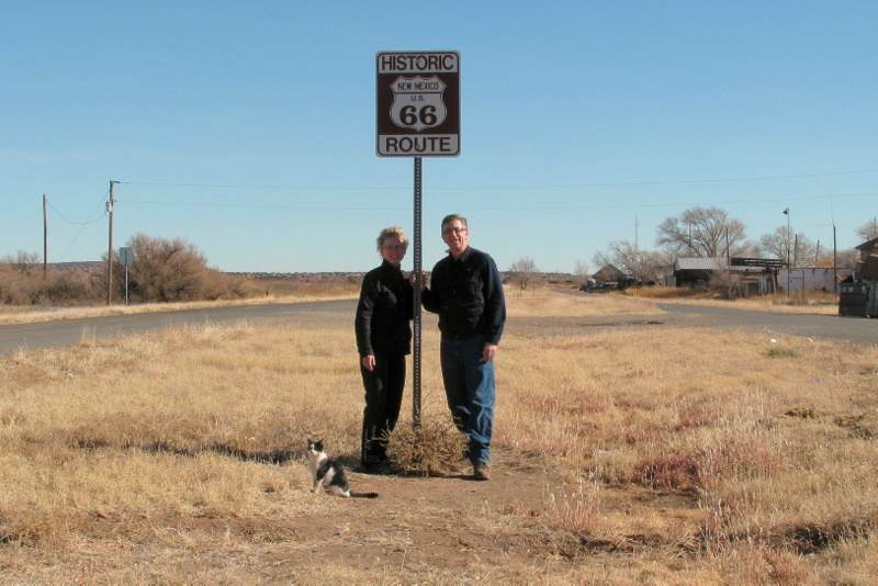 Wind blown confluence hunters with historic Route 66 sign ... and friendly local cat