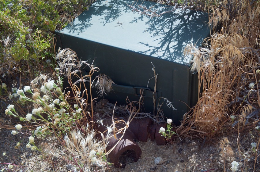 A 'geocache' box (new in the past 10 years), next to the confluence point's famous rusted steel pipe