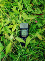 #2: Shaken camera picture of GPS on ground at confluence