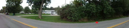 #1: Panoramic view from the west side of the road. CP is marked by the red star.