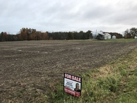 #9: Confluence field from the west-southwest, showing For Sale sign.