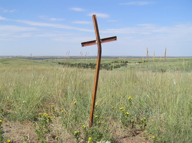 Cross in the ground about 25 meters south-southwest of the confluence.