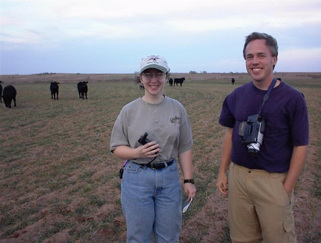 Daphne and Jim at the confluence, with the cows edging closer