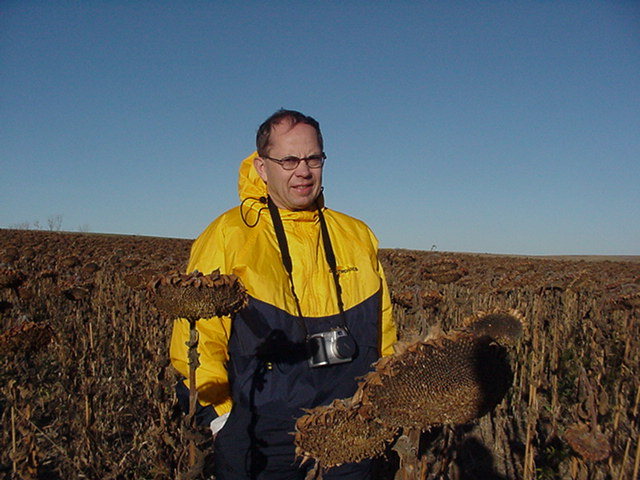 Larry Simonson at the site (& sunflowers)