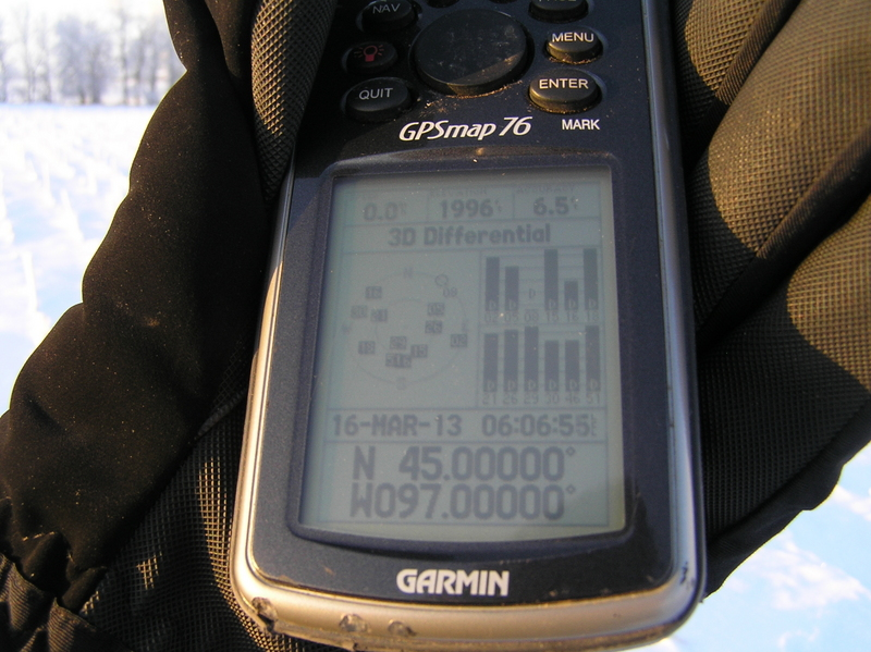 Gloved but frozen fingers:  Holding GPS receiver at 45 North 97 West.