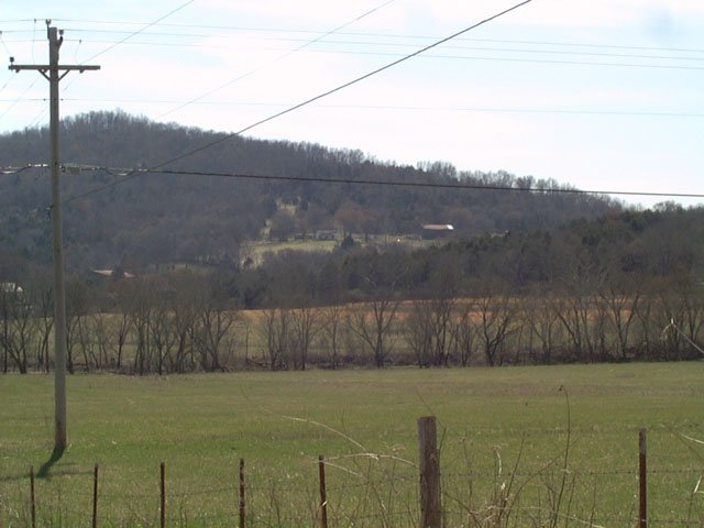The house and the hill that overlook the confluence area