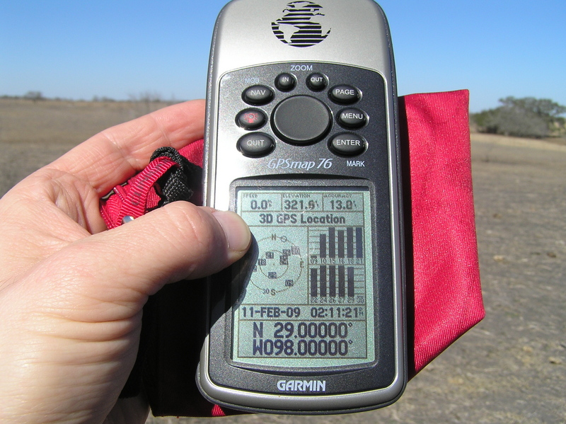 GPS receiver at the confluence with a view of the horizon.