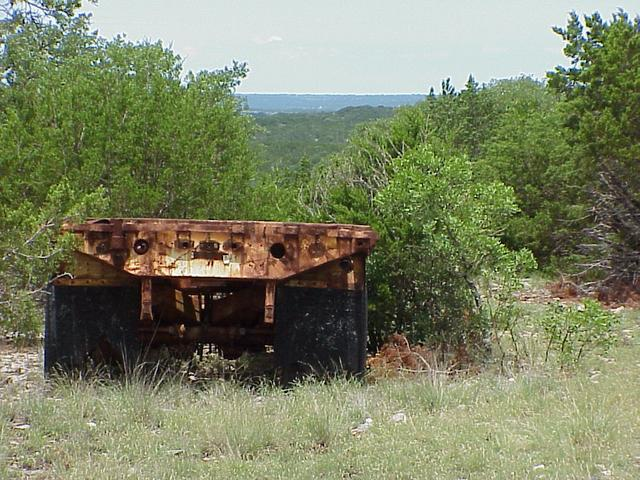Rusting trailer parked about 10 meters north of the confluence