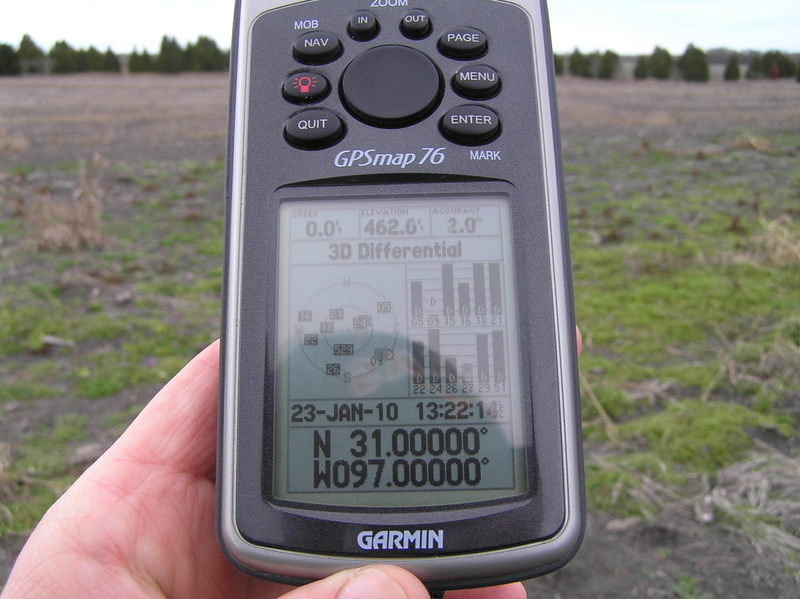 GPS reading at the confluence point under a big Texas sky.