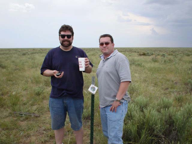 From left:  fencepost driver, Garmin, Todd, ranch cup, confluence marker, & Steve