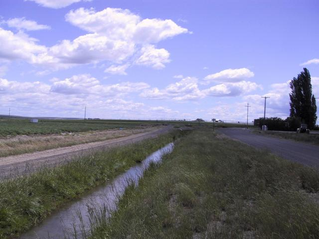 View southeast along canal and road toward Roloff Road.