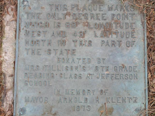 Plaque commemorating the confluence, at corner of West Deyer Place and S. 70th St., 15 meters north of the confluence.
