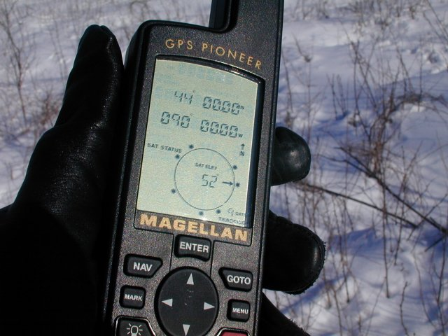Close up shot of my trusty Magellan GPS Pioneer readout at the confluence point.
