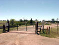 #4: The gate blocking the dirt road along the Union Pacific railroad tracks.