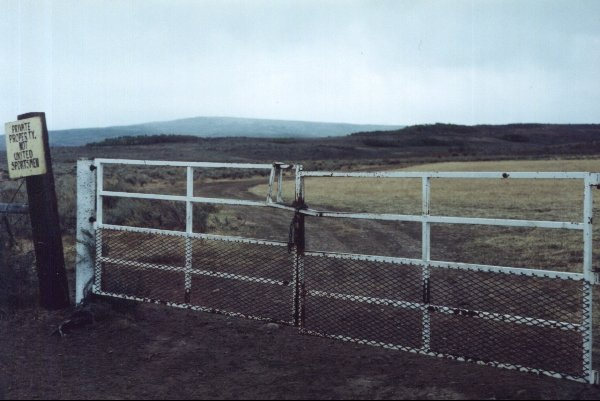 First locked gate, looking south.  Confluence is 2.74 kilometers away.