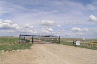 #1: No trespassing sign and gate barring access to the area near the confluence on the approach from the west.