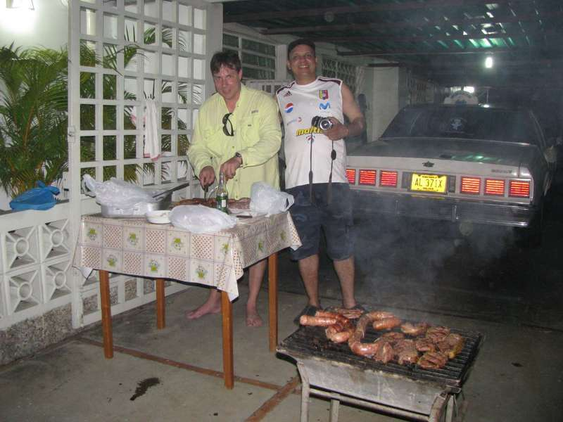 CELEBRATING AT NIGHT WITH A GREAT BBQ HERNAN AND TOMAS ARE OUR CHEF