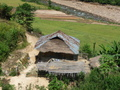#4: Typical house on the way to the confluence with sustenance of dried river fish and rice fields.