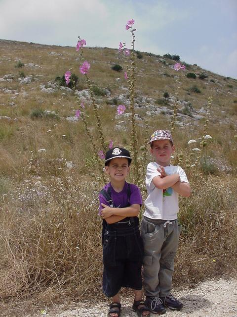 Tal & Omer next to a local flower