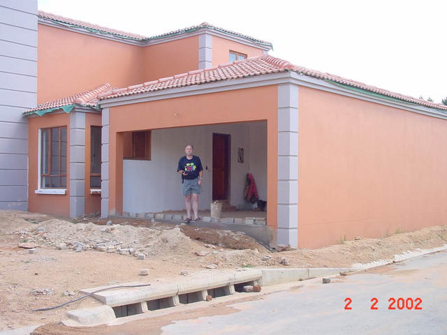 Closer view of the garage, with Pete standing in the entrance.