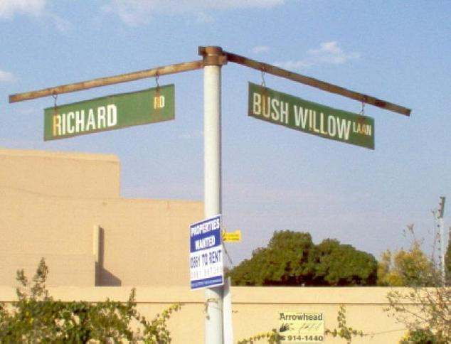Street signs just outside entrance of complex