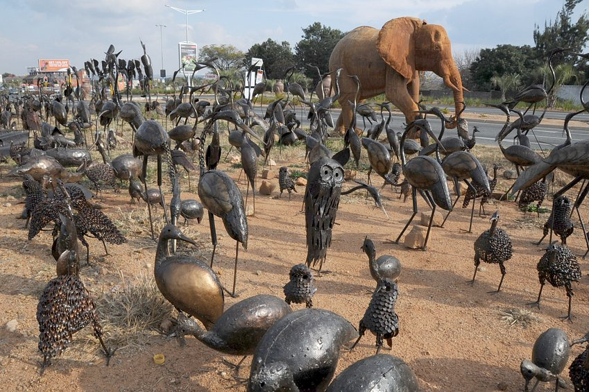 Roadside metal sculptures by Zimbabwean refugees ranging from owls to elephant