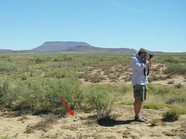 My brother Cecil, taking the shots for a panoramic 360°. The GPS is pointed out by the red arrow.